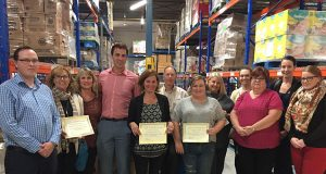 Whitby Chamber members and neighbouring chambers and boards of trade pose for group photo in Feed the Need warehouse.